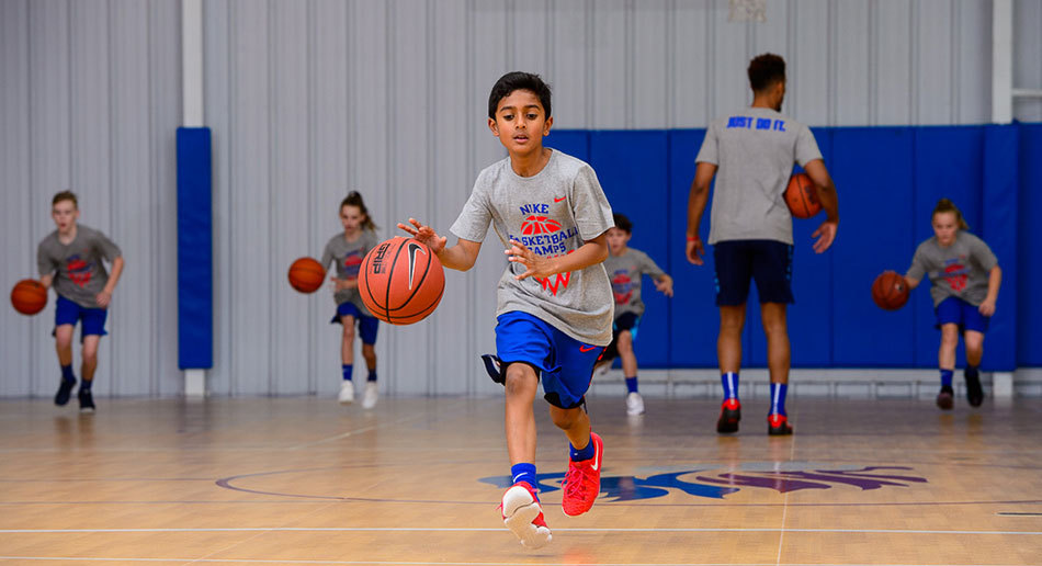 Improve your game and have serious fun at Nike Basketball Camps. Watch Video