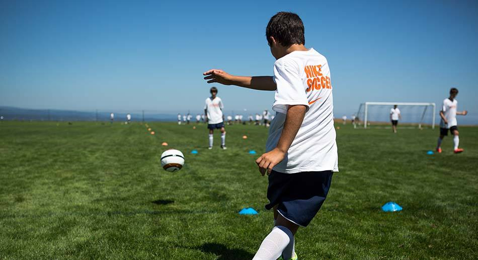 cc29428a4 Kids Trophy Picture Hands In Nova 2013 Nike Soccer Camps 10 ...